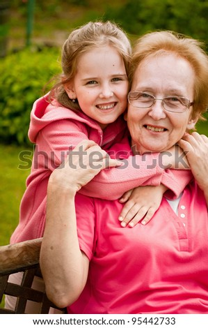 Love - grandmother with granddaughter portrait - stock photo