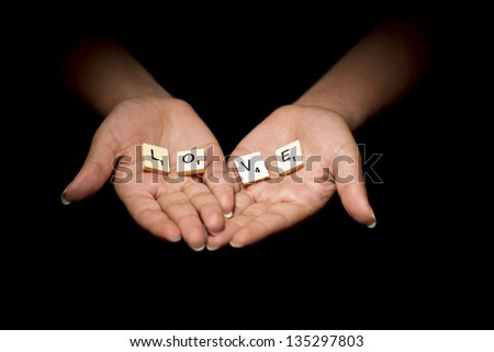 Love Hands in black background - stock photo