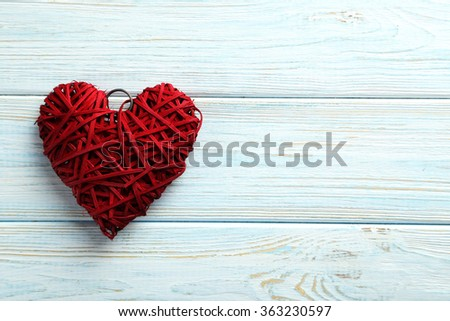 Love heart on a blue wooden background - stock photo