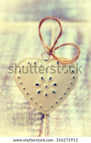 Love heart on wooden texture background, valentines day card concept - stock photo