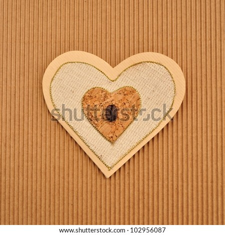 Love heart shape paper card or menu book cover. Handmade using brown, beige and tan paper. - stock photo