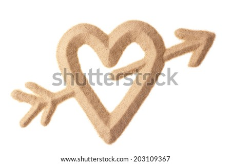 love heart with Cupid arrow sculptured in sand - stock photo