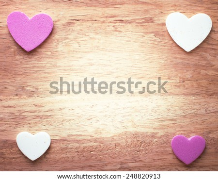 Love hearts on vintage wooden for Valentine day. - stock photo