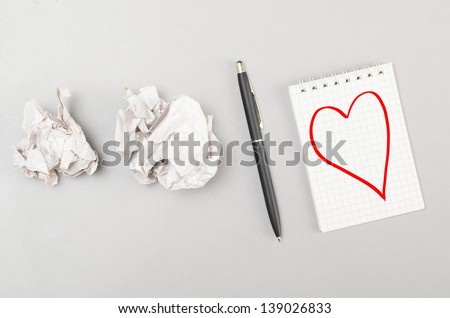 love letter. crumpled wads and notebook with heart picture - stock photo