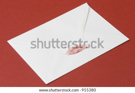 Love letter sealed with a loving kiss, on red background - stock photo