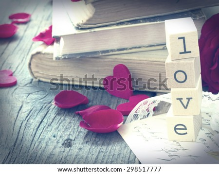 love letter with old books and red rose,vintage  concept of memory - stock photo