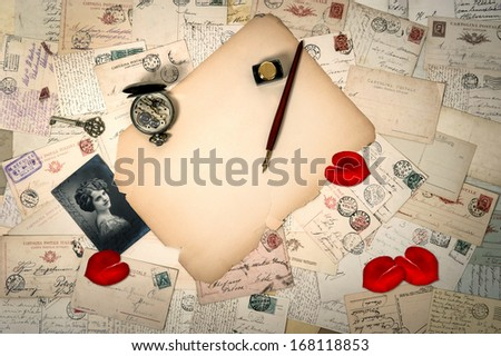 Love letters and postcards. sentimental vintage background. Heart shaped rose flower petals. Valentine's Day. Art Deco - stock photo
