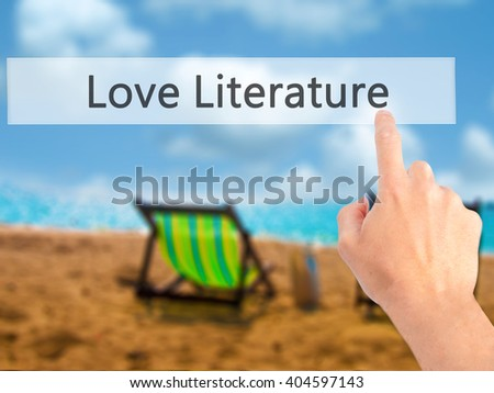 Love Literature - Hand pressing a button on blurred background concept . Business, technology, internet concept. Stock Photo - stock photo