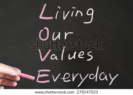 Love - Living our values everyday words written on the blackboard using chalk - stock photo