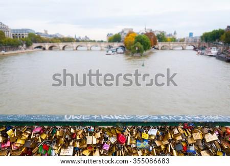 Love locks bridge in Paris. - stock photo