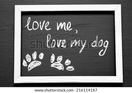 Love me, love my dog written with Chalk on Blackboard - stock photo