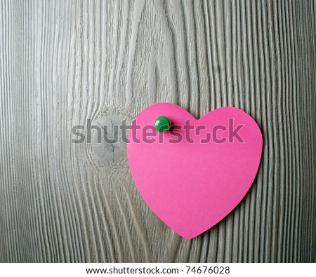 Love message on a wooden background - stock photo