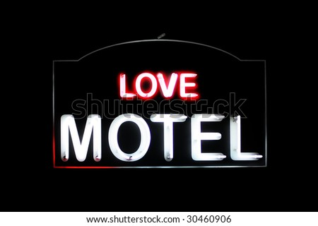 Love Motel white and red neon sign - stock photo