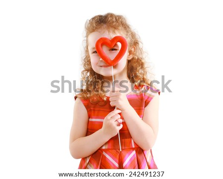 Love, mother's day, valentine's day and people concept - happy little girl looking through the heart - stock photo
