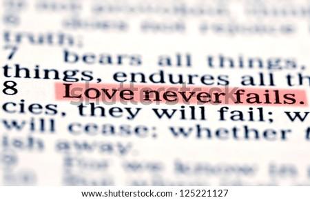 Love never fails. Corinthians 13 Holy bible - stock photo