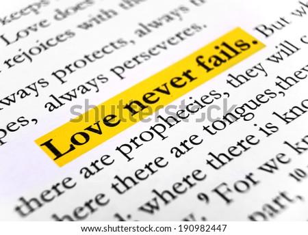 Love never fails. 1Corinthians 13:8, Holy bible. - stock photo