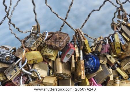 Love padlock on the bridge of Paris, France Love Locks on Pont des Arts Bridge over the Seine River in Paris, France - stock photo