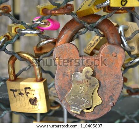 Love padlocks on a bridge in Paris, France - stock photo