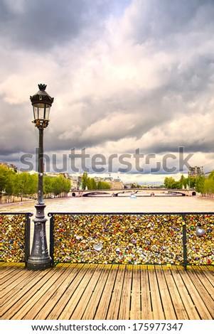 Love padlocks on Pont des Arts bridge, Seine river in Paris. France, Europe. - stock photo
