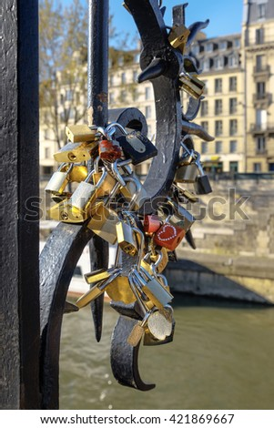 Love padlocks on the railing by the river Seine in Paris - stock photo