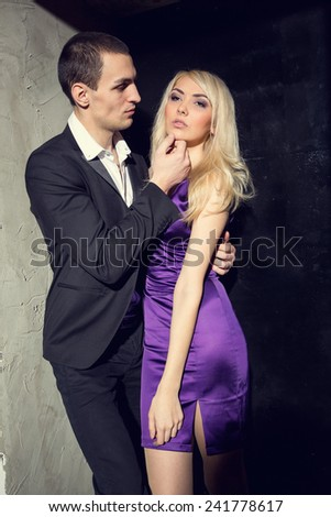 Love, passion, jealousy, loyalty, feelings, sex - emotions loving couple. Beginning of a Love Story. Young couple in love. Loving couple standing in doors together while woman hugging her boyfriend. - stock photo