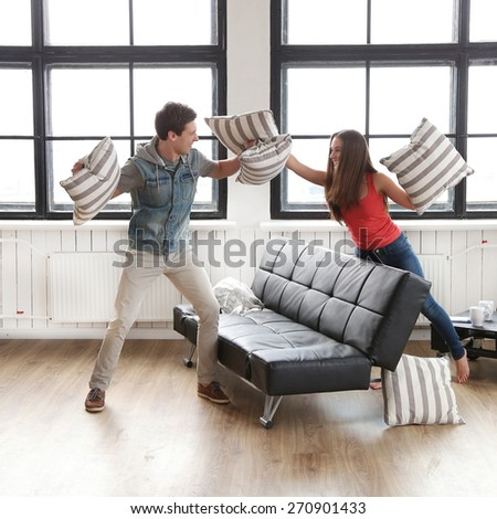 Love, relationship. Beautiful couple at home - stock photo
