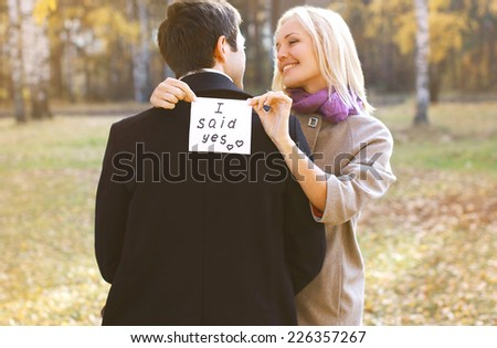 Love, relationships, engagement and wedding concept - man proposing ring woman outdoors, happy romantic couple - stock photo