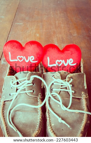 Love sign in old shoes, valentine day. - stock photo