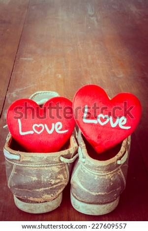 Love sign put in old shoes, Valentine day. - stock photo