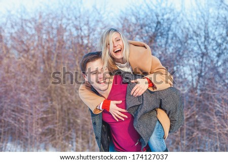 love story man and woman walking in the park - stock photo