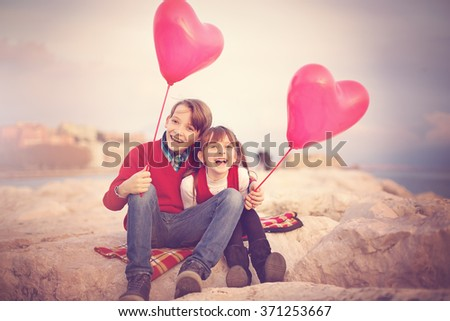 Love story. Valentines day. Kids couple outdoors - stock photo