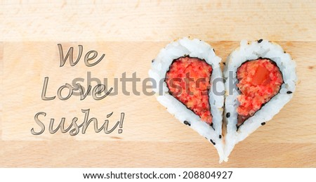 Love sushi concept with two pieces of sushi forming the heart shape - stock photo