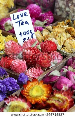 Love Tea with flowers on a bazaar (manual focus) - stock photo