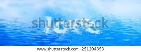 Love text in clean water, calm waves. Banner, panorama. - stock photo