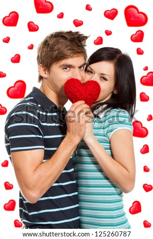 love valentine day couple holding red heart, kissing behind a red heart, happy smile hug looking at camera, isolated over white background, concept hearts flying around - stock photo