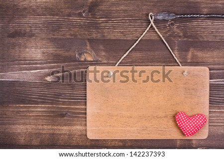 Love Valentine heart, signboard hanging on vintage wood background - stock photo