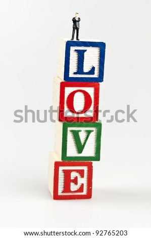 Love word and toy business man - stock photo