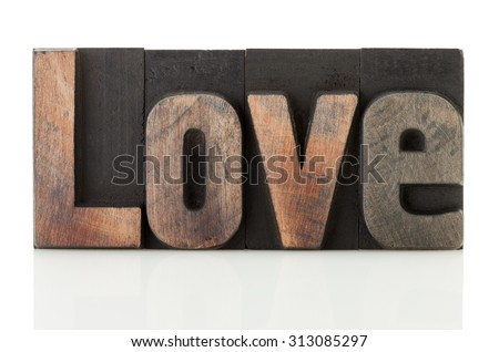 Love, word written with vintage letterpress printing blocks isolated on white background - stock photo