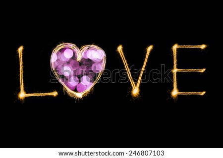 Love writing by sparkler firework isolated on black background for Valentines day - stock photo