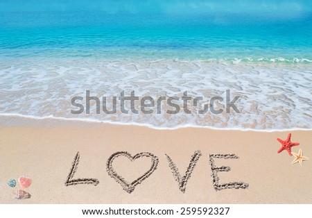 love written on a tropical beach - stock photo