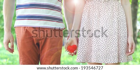 love young girl boy heart in hand  - stock photo