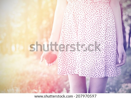 love young girl heart in hand vintage photo retro style - stock photo