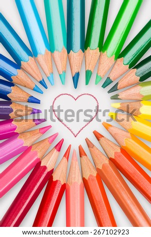 Love your arts and creativity, color pencils arranged in heart shape - stock photo