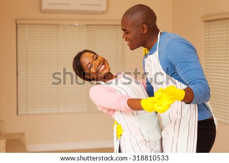 lovely african american couple dancing in their new home - stock photo