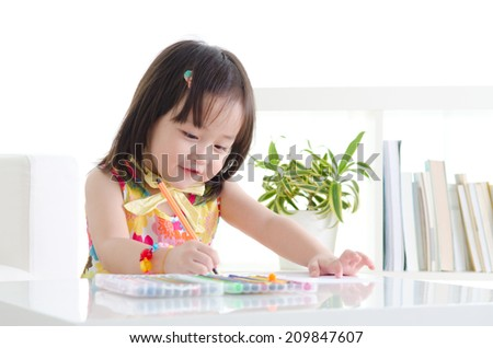 Lovely asian girl drawing with colored pencil - stock photo