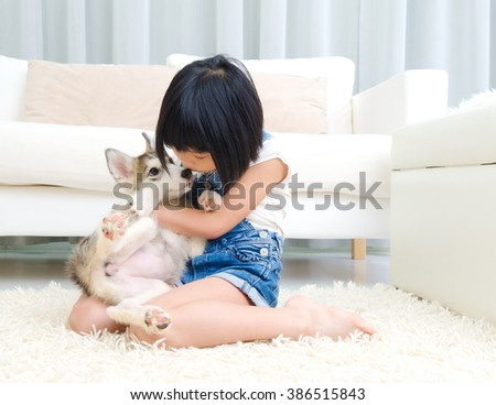 Lovely asian girl kiss her puppy - stock photo
