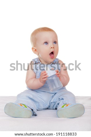 Lovely baby sitting on the floor with a bottle isolated on white background - stock photo