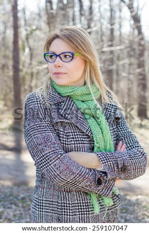 Lovely Beautiful Carefree Young Caucasian Woman Portrait outdoor. Winter Autumn season daylight cheerful lifestyle. - stock photo
