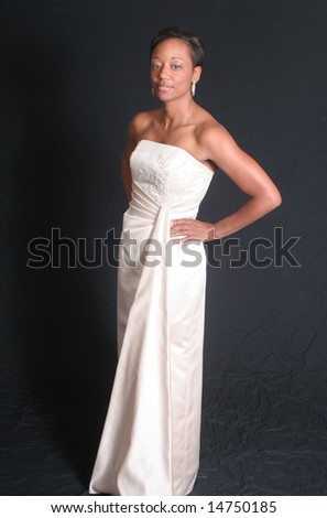 Lovely black woman in formal dress - stock photo