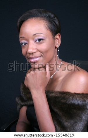 Lovely black woman with chin on her hand - stock photo